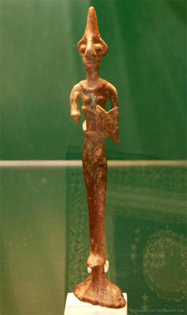 A bronze figure of a deity from Alalakh.