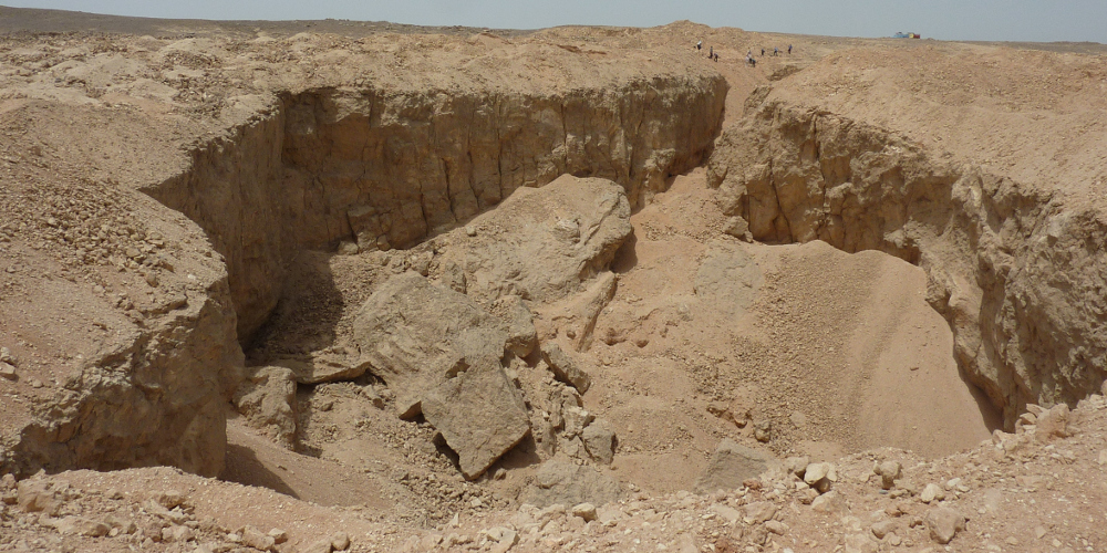 An ancient Egyptian stone quarry at Hatnub. These quarries were sometimes used as jails.