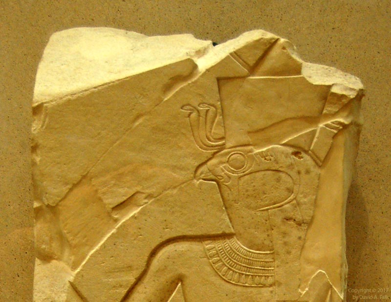 A relief of Montu at Tod with two Wadjet amulets